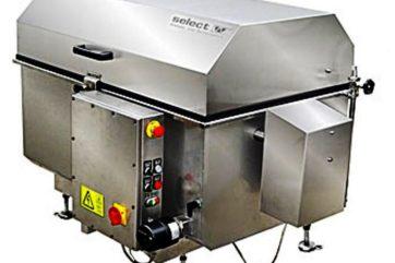 Lavadora de cinta móvil para la limpieza automática de cintas transportadoras, sobre todo, para la industria alimentaria.